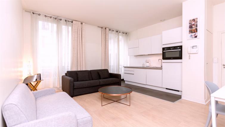 Sofa at Drouots Apartments - Citybase Apartments