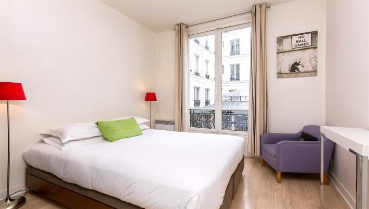 Double bed at Drouots Apartments - Citybase Apartments