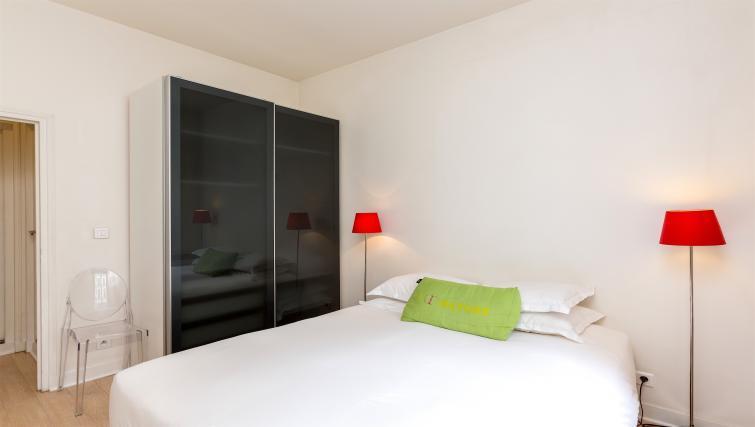 Bed at Drouots Apartments - Citybase Apartments