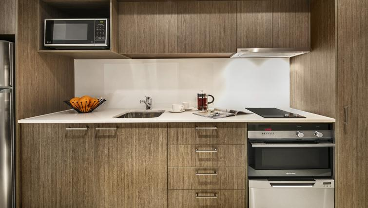 Kitchen facilities at Quest Mounts Bay Road Apartments - Citybase Apartments
