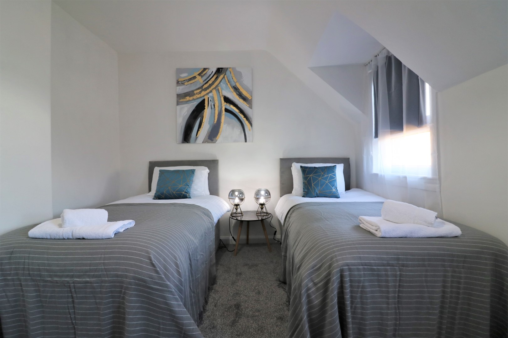 Twin beds at Jess View Apartment - Citybase Apartments