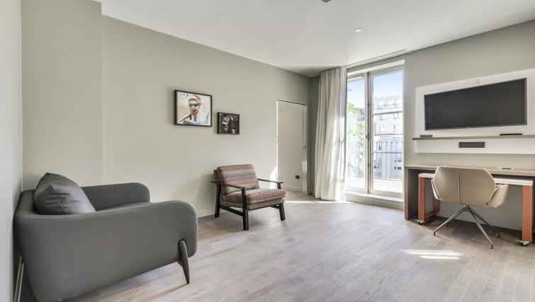 Living area at Mode Arc De Triomphe Apartments - Citybase Apartments