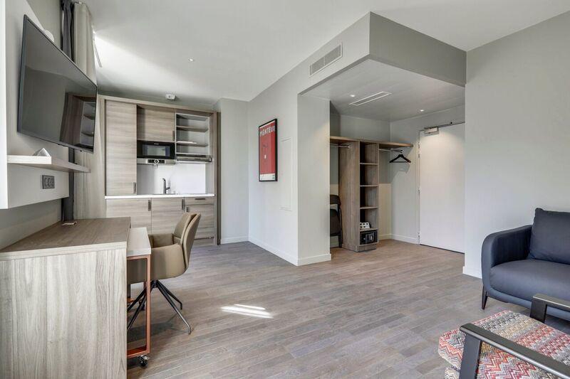 Lounge at Mode Arc De Triomphe Apartments - Citybase Apartments