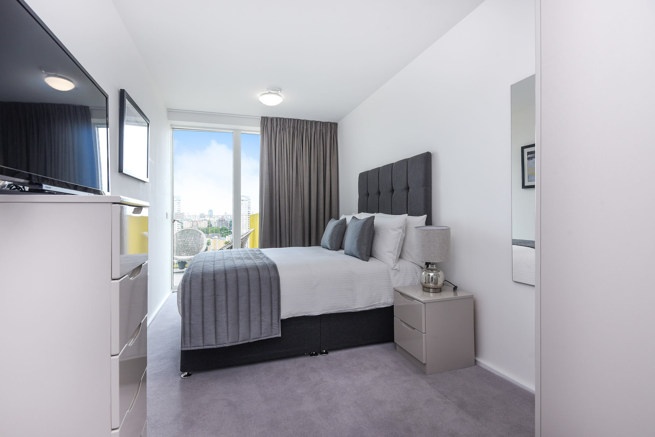 Modern bedroom at Millharbour Residences - Citybase Apartments