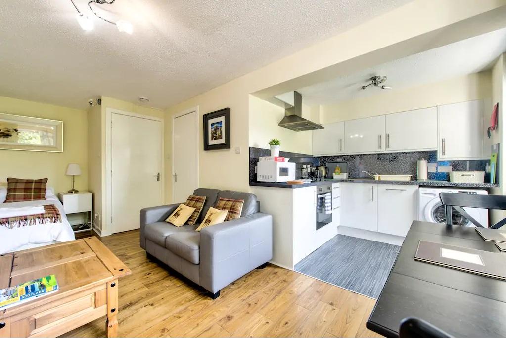 Open-plan living area at Grassmarket Studio Apartment - Citybase Apartments