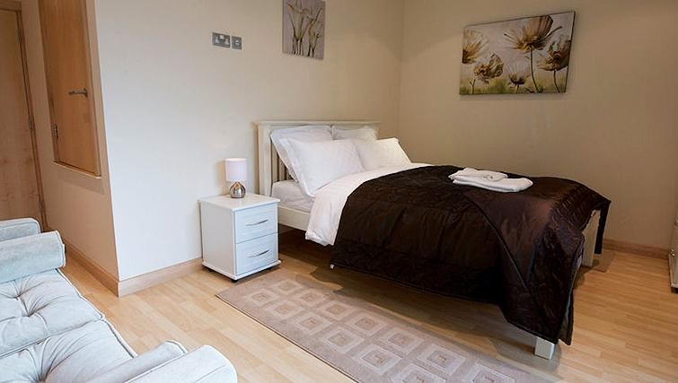 Compact bedroom at Deansgate Apartments - Citybase Apartments