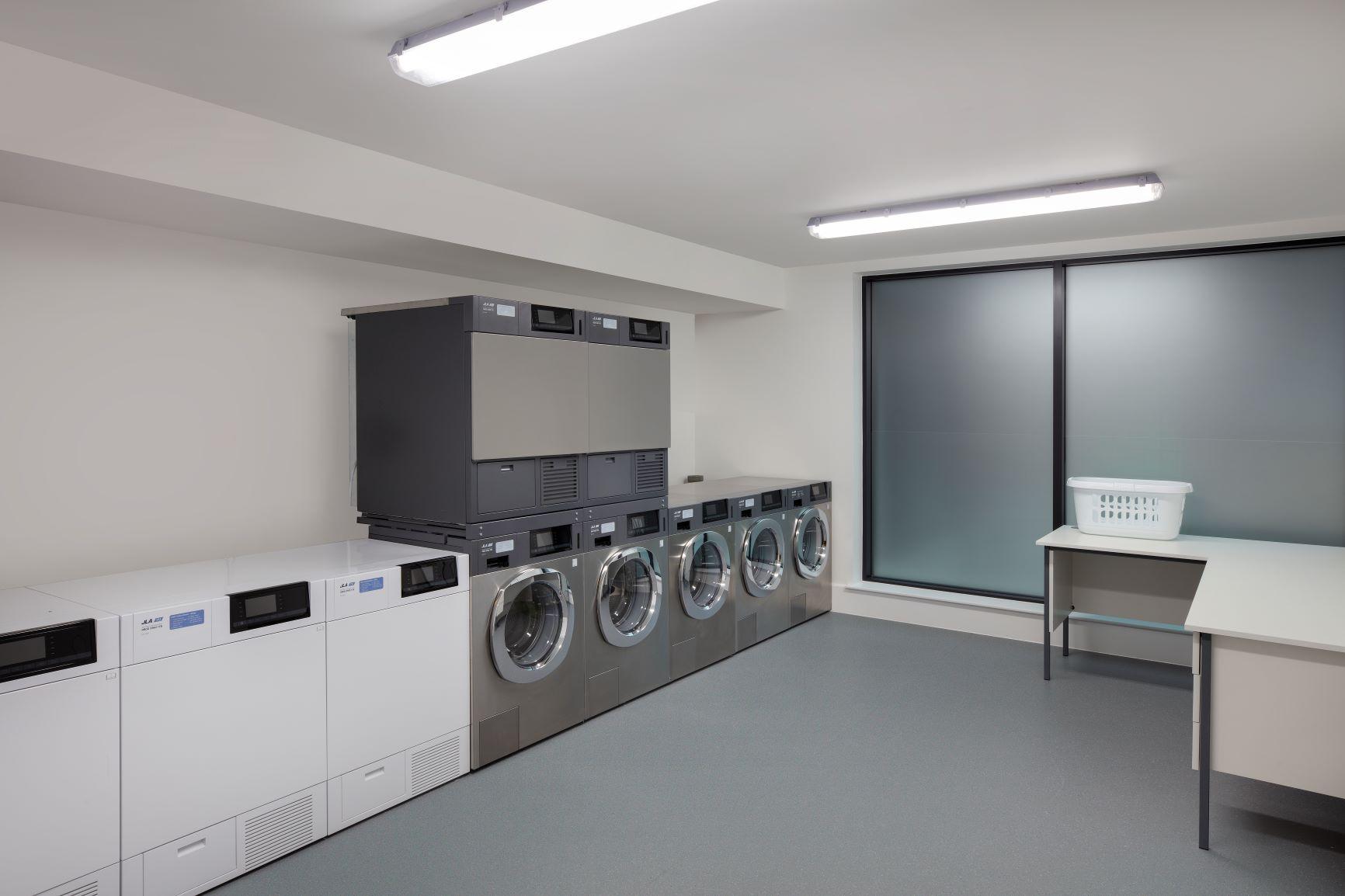 Laundry room at Staybridge Heathrow Apartments - Citybase Apartments