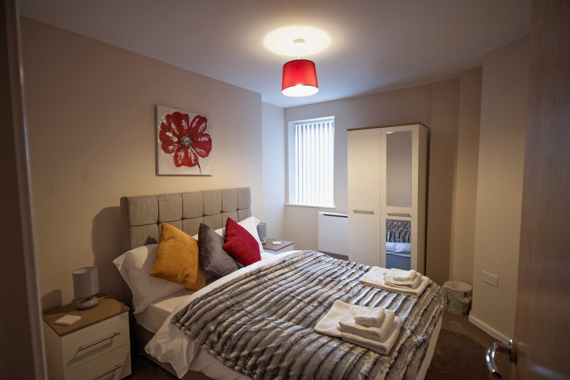 Cosy bedroom at Centauri Park Rise Apartments - Citybase Apartments