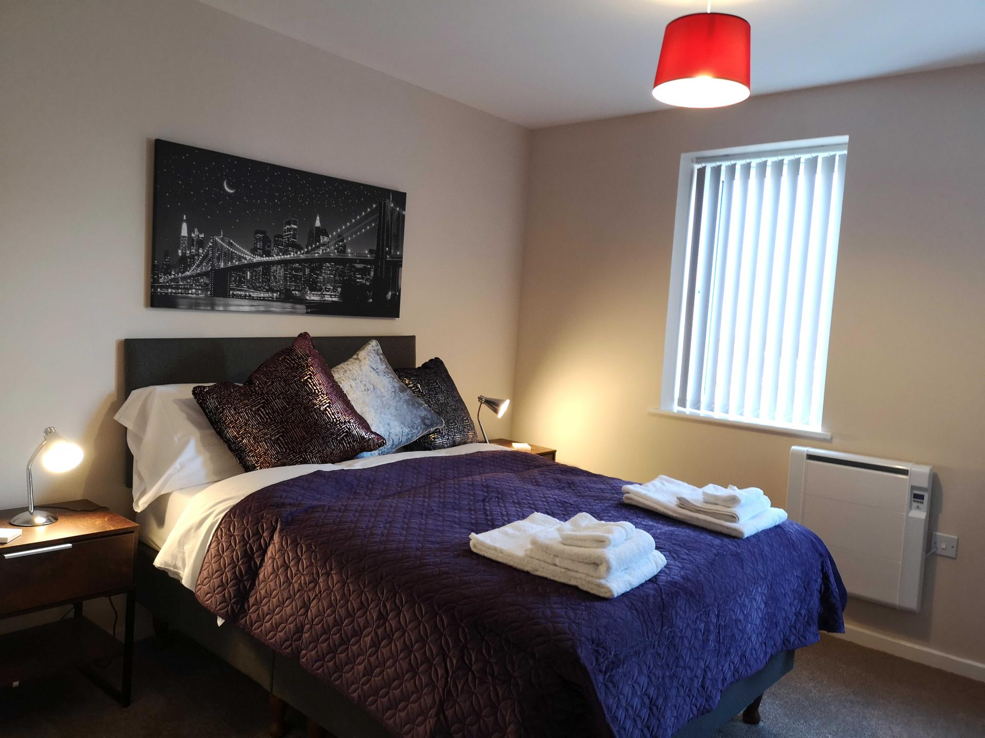 Stylish bedroom at Centauri Park Rise Apartments - Citybase Apartments