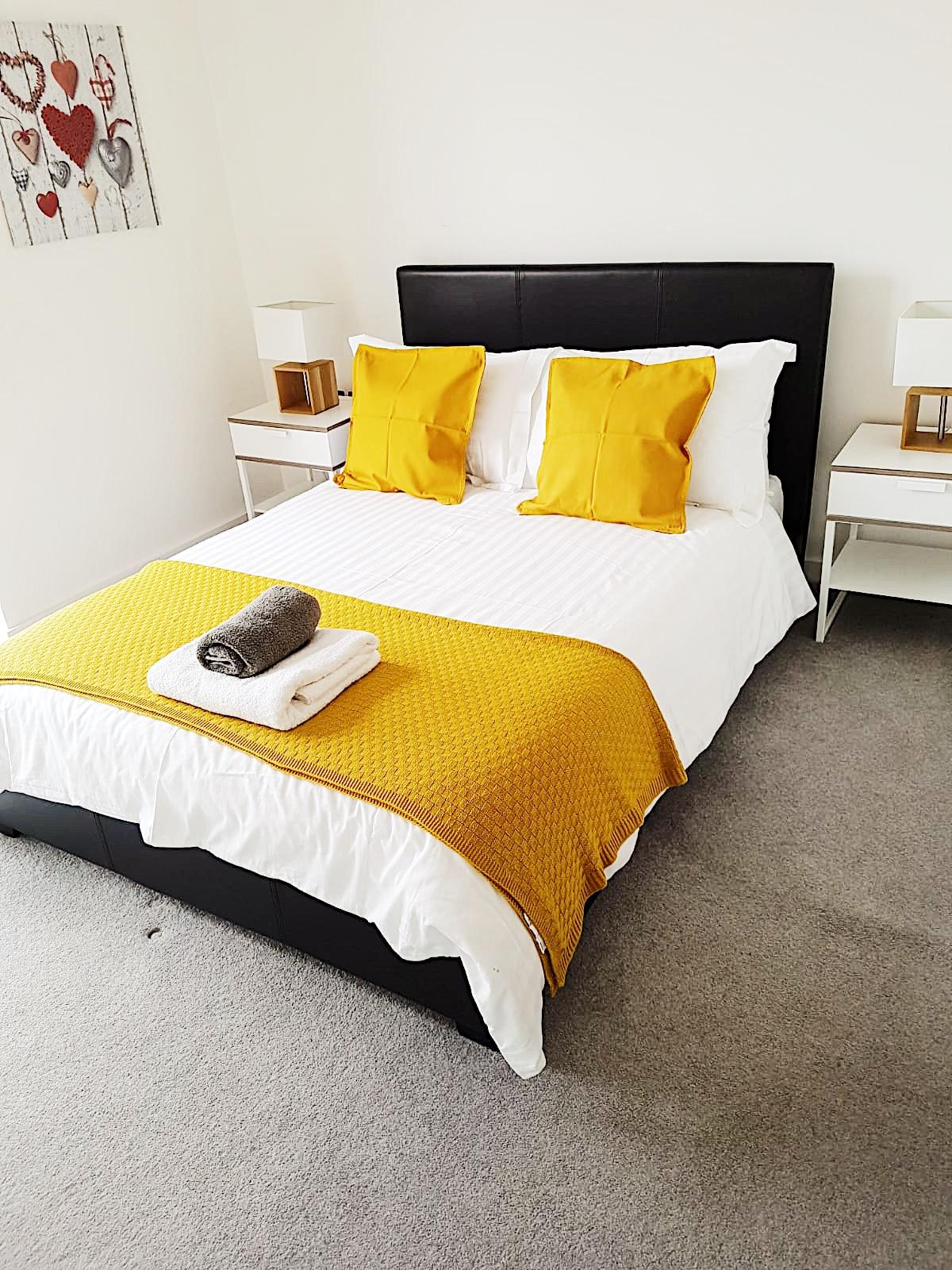 Bright bedroom at Ekhaya Apartments - Citybase Apartments