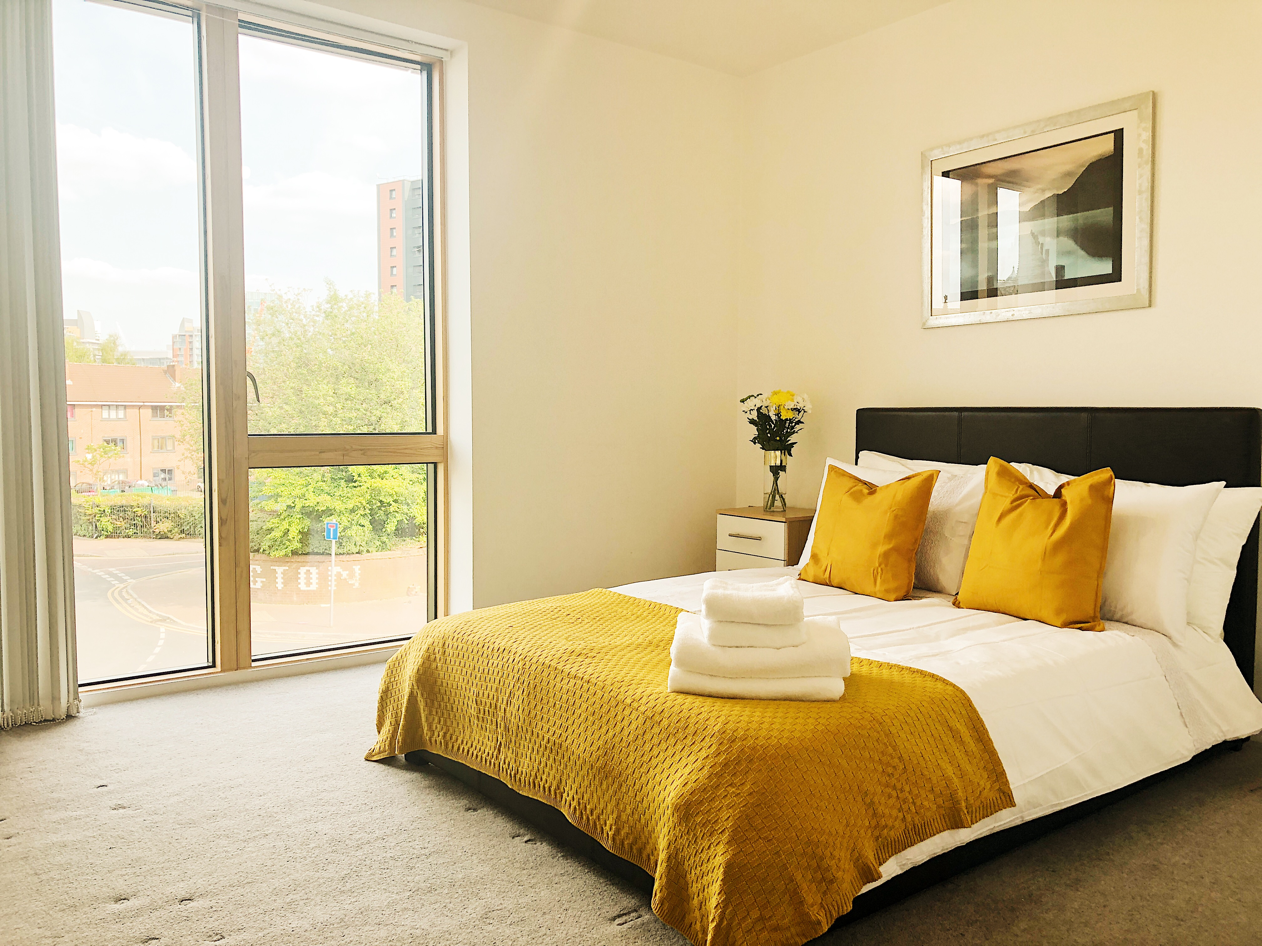 Spacious bedroom at Ekhaya Apartments - Citybase Apartments