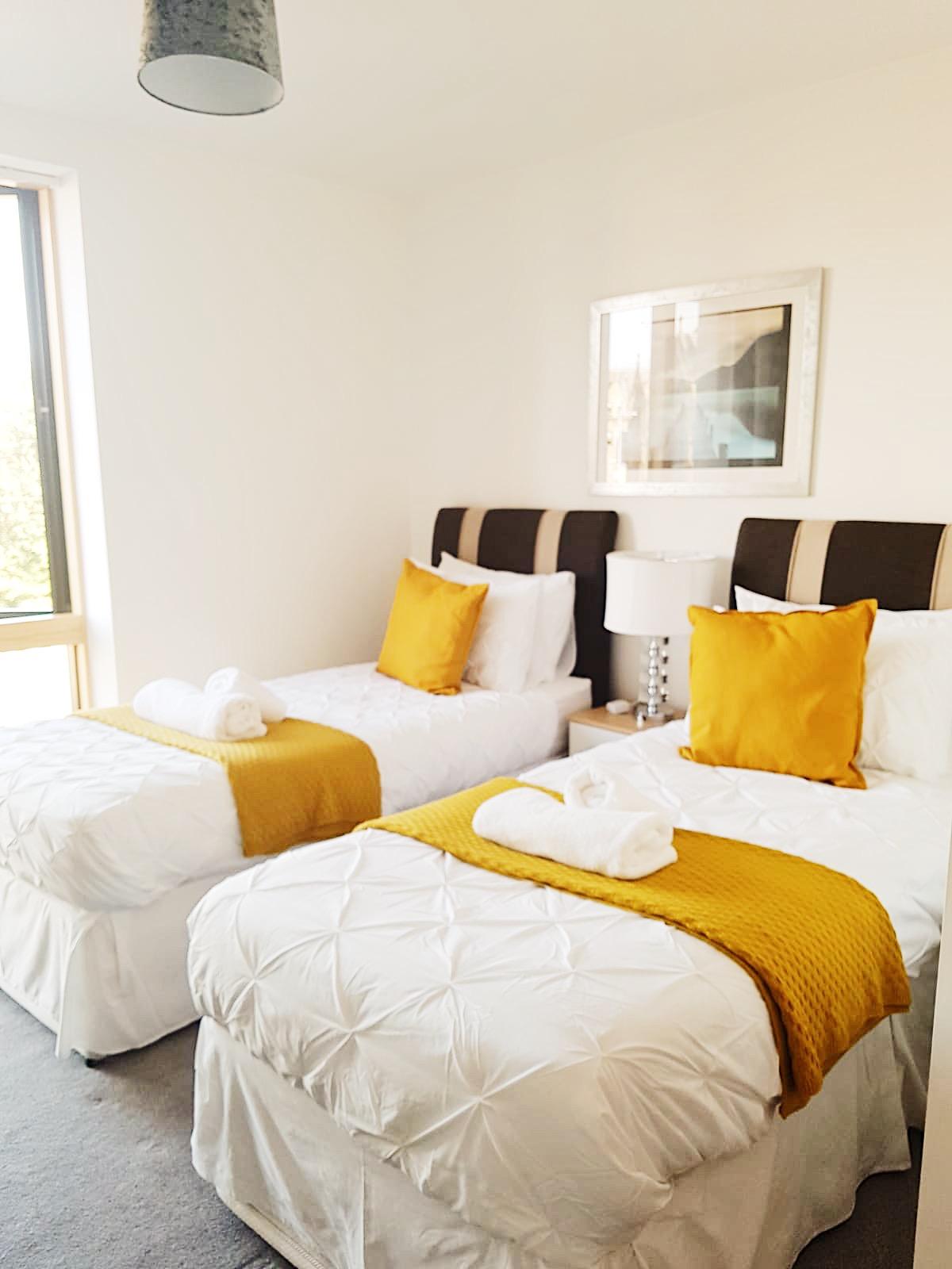 Twin beds at Ekhaya Apartments - Citybase Apartments