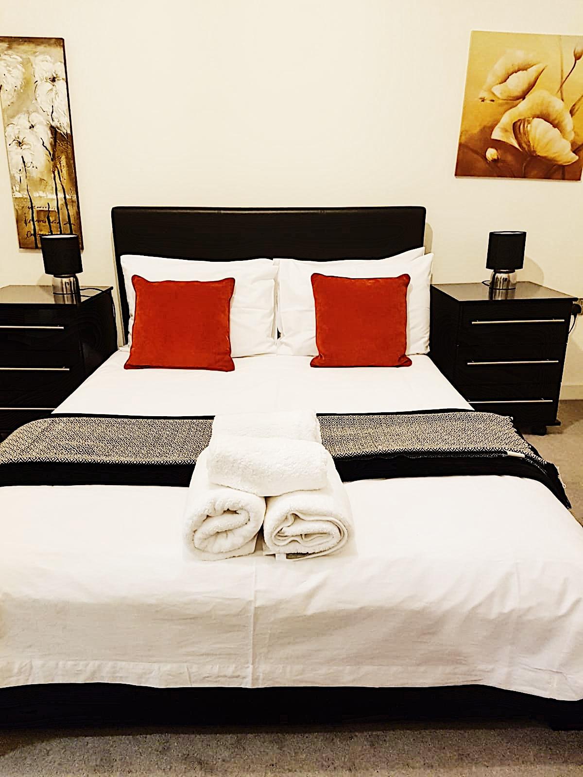 Comfortable bedroom at Ekhaya Apartments - Citybase Apartments