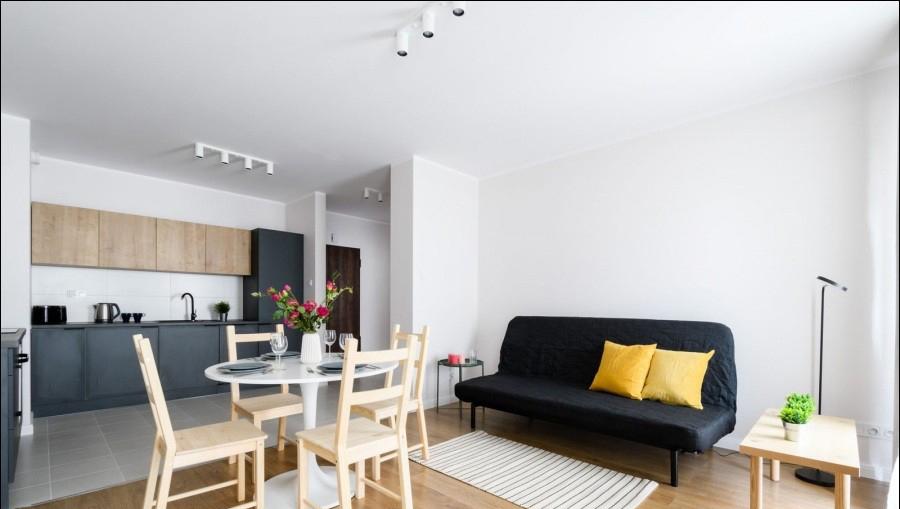 Living area at Apartments Soho Factory - Citybase Apartments
