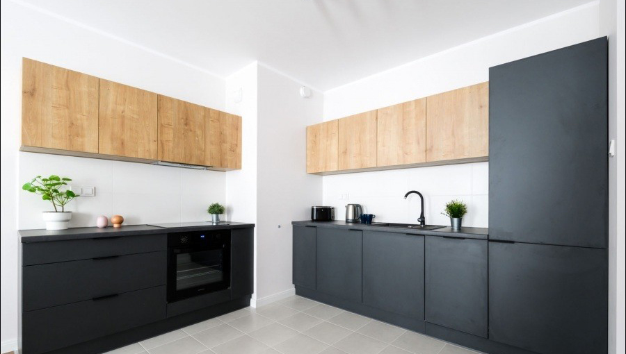 Modern kitchen at Apartments Soho Factory - Citybase Apartments
