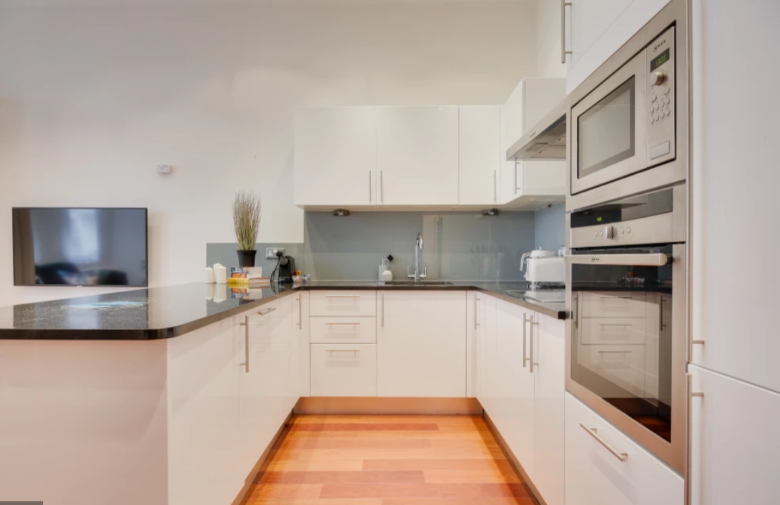 Modern kitchen facilities at Lexham Gardens Apartments - Citybase Apartments