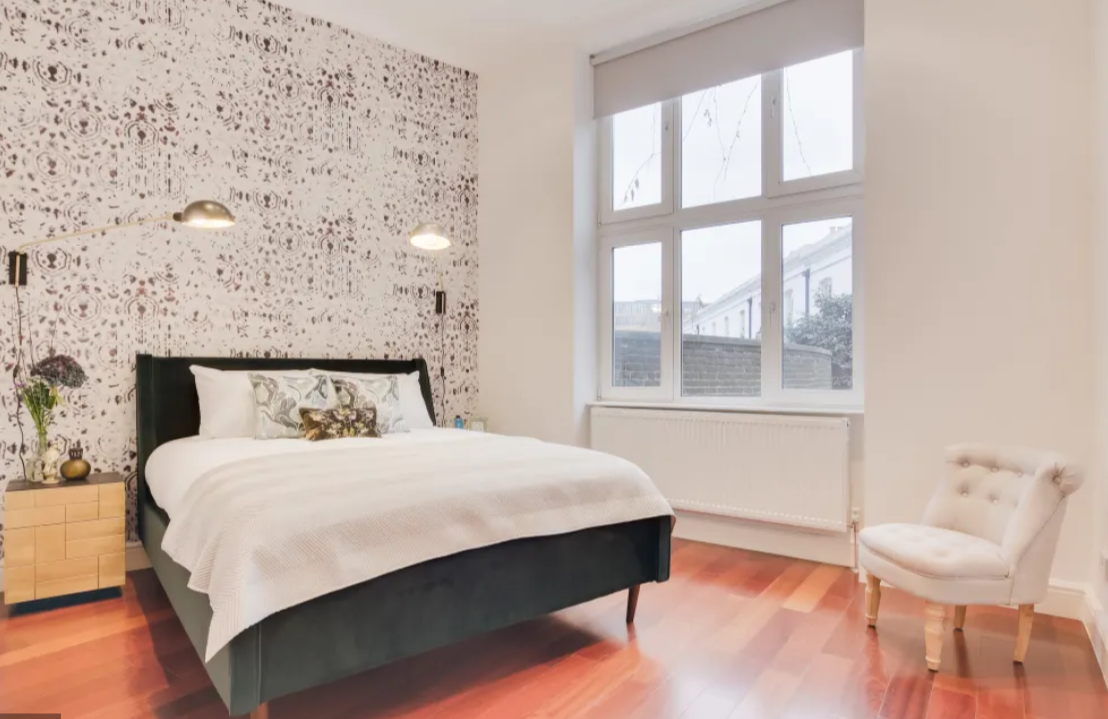 Bright bedroom at Lexham Gardens Apartments - Citybase Apartments