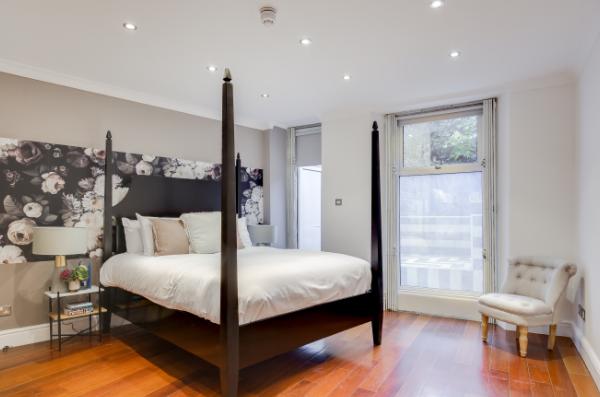 Master bedroom at Lexham Gardens Apartments - Citybase Apartments