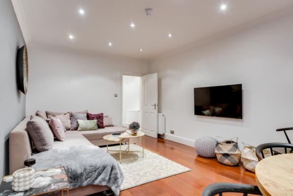 Spacious lounge at Lexham Gardens Apartments - Citybase Apartments