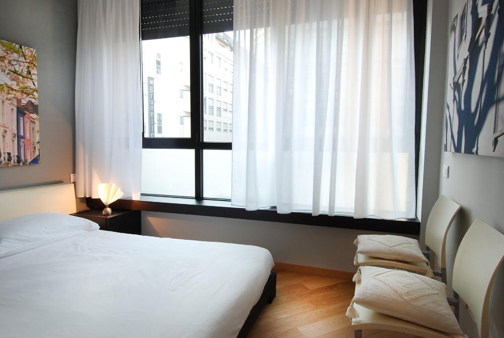 Bedroom at Larga Apartment - Citybase Apartments