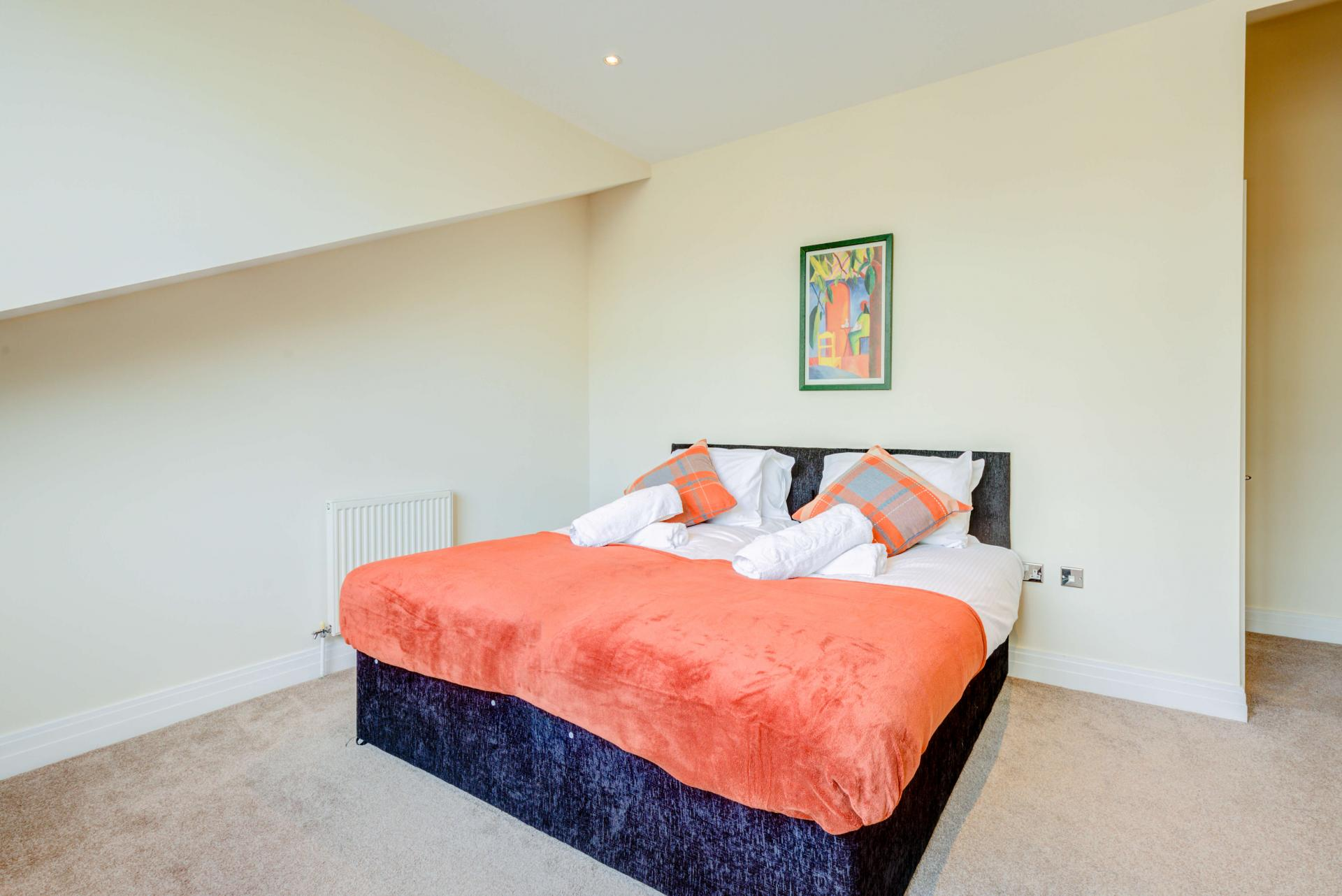 Spacious bedroom at Town Meadow Apartment - Citybase Apartments