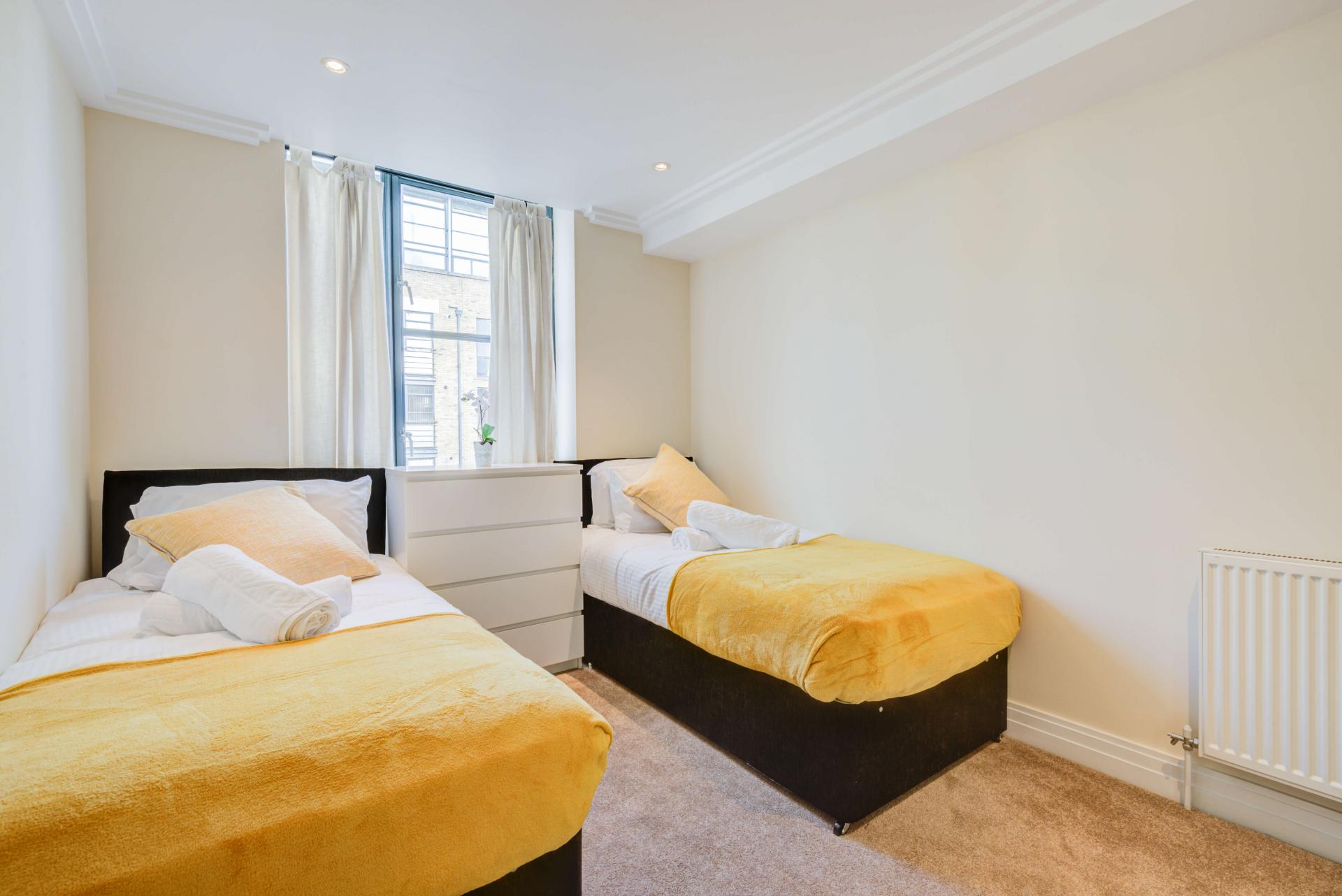 Bright bedroom at Town Meadow Apartment - Citybase Apartments