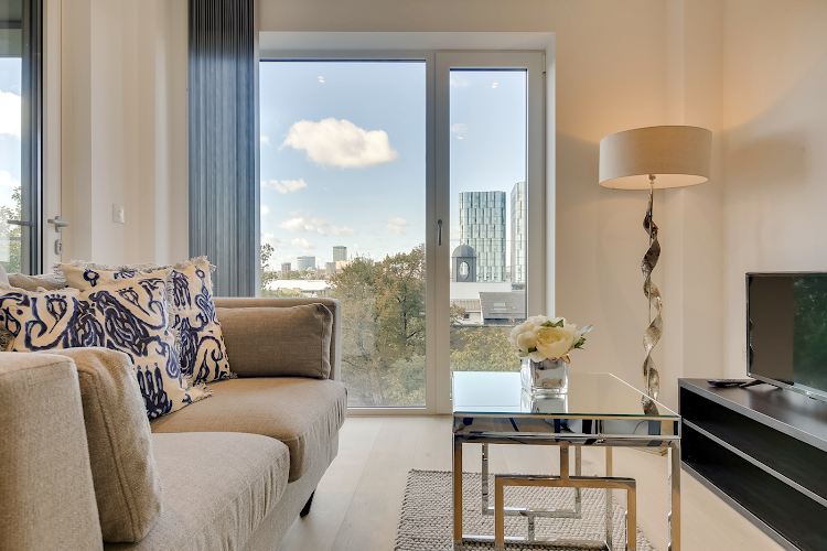 Living room at Emerson Court Apartments - Citybase Apartments