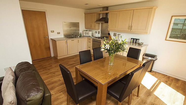 Kitchen/dining area at Ocean Serviced Apartments - Citybase Apartments