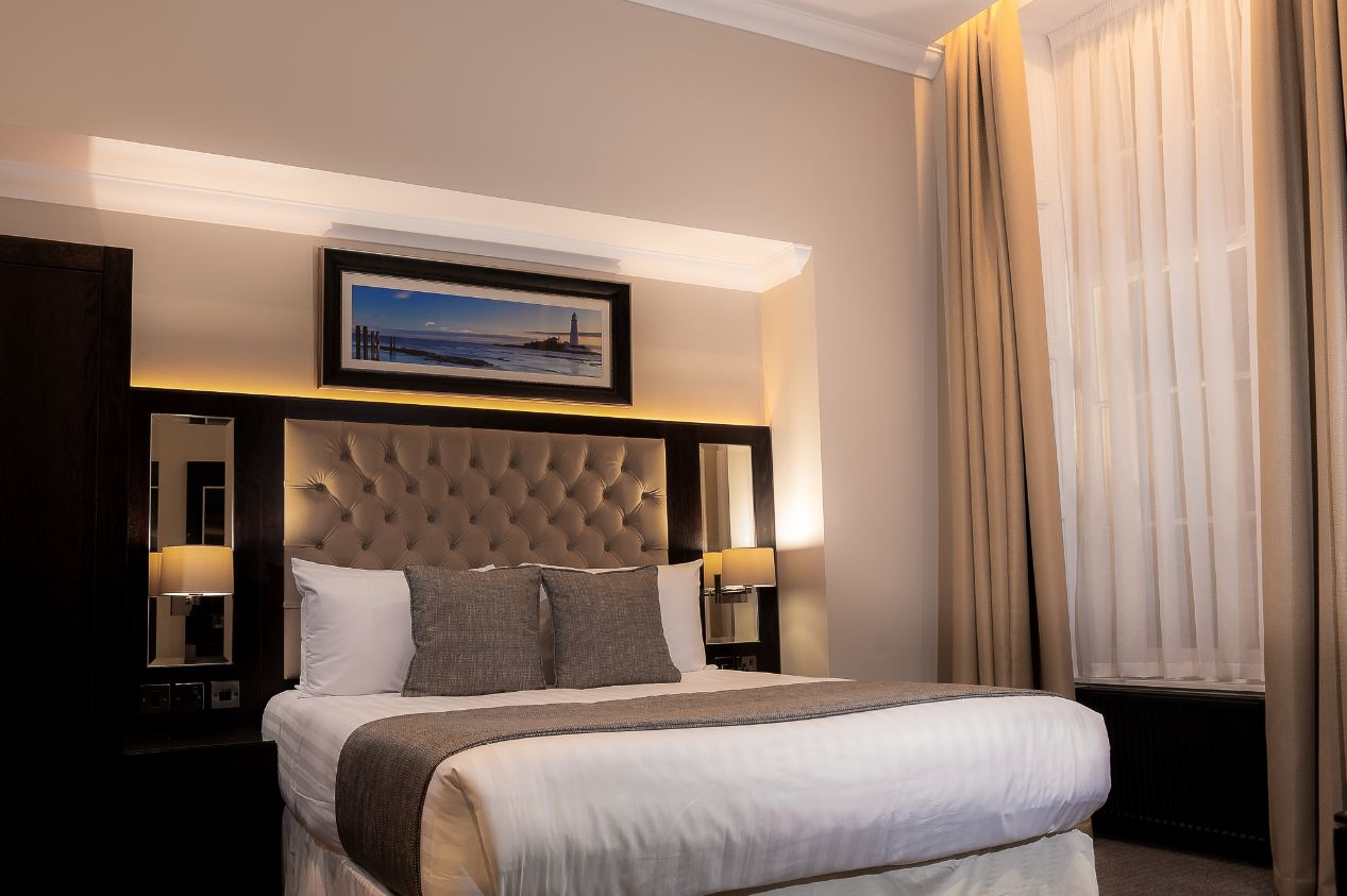 Bedroom at County Aparthotel - Citybase Apartments