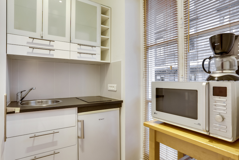 Kitchen at Rue Marsollier Apartment - Citybase Apartments