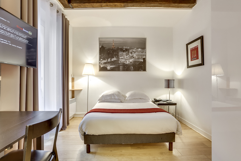 Bedroom at Rue Marsollier Apartment - Citybase Apartments