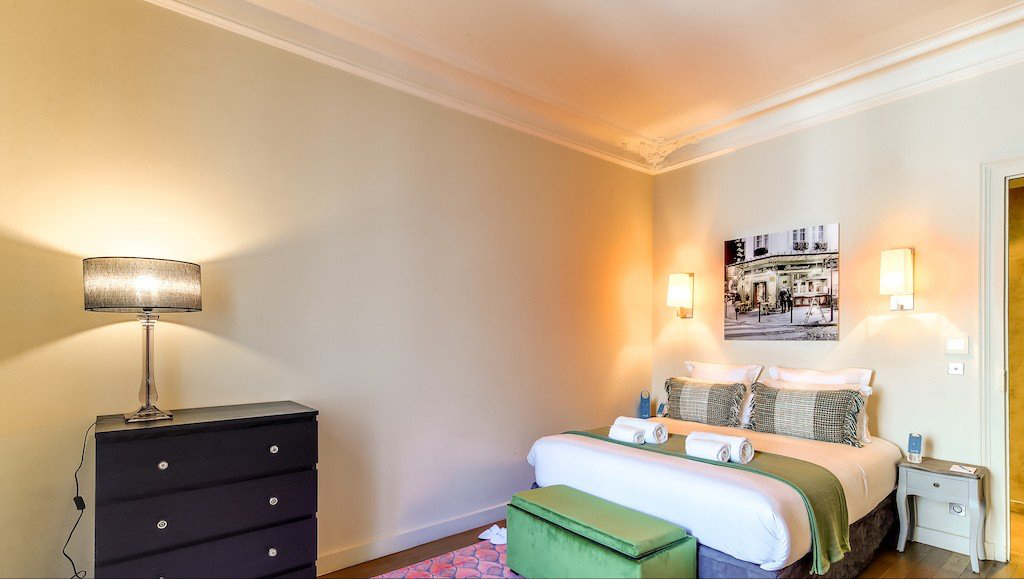 Stylish bed at Montaigne Apartments - Citybase Apartments