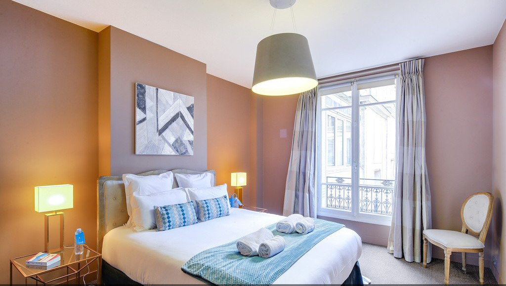 Comfortable bed at Montaigne Apartments - Citybase Apartments