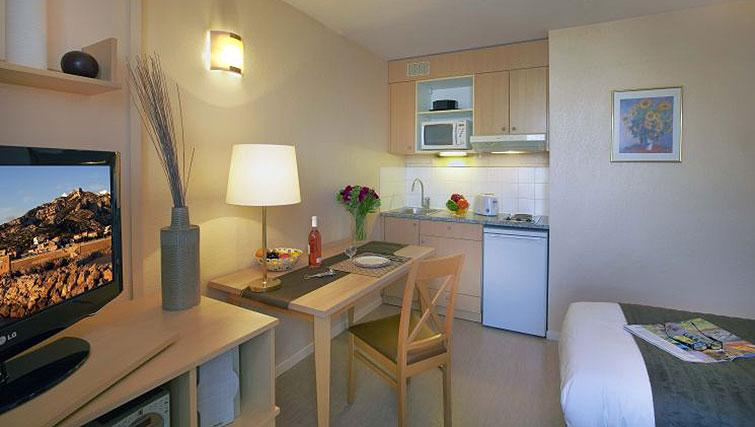 Tidy kitchen in Citadines Prado Chanot Apartments - Citybase Apartments