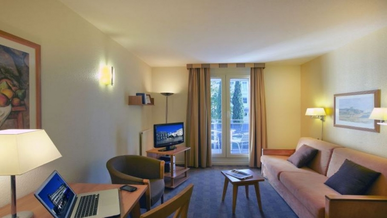Sophisticated living area in Citadines Antigone Apartments - Citybase Apartments