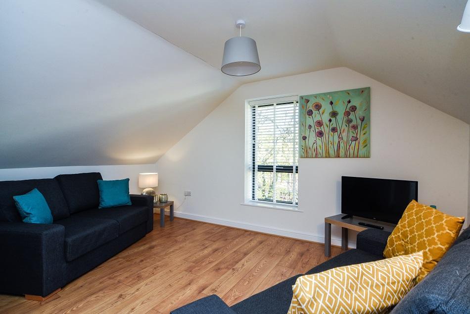 Living room at Hamilton Lodge - Citybase Apartments