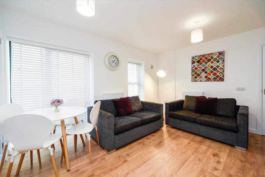 Spacious living area at Hamilton Lodge - Citybase Apartments