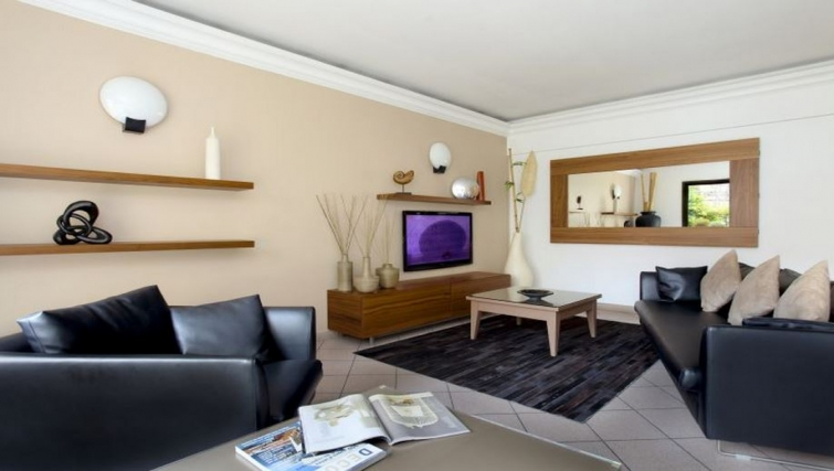 Comfortable living area in Citadines Castellane Apartments - Citybase Apartments