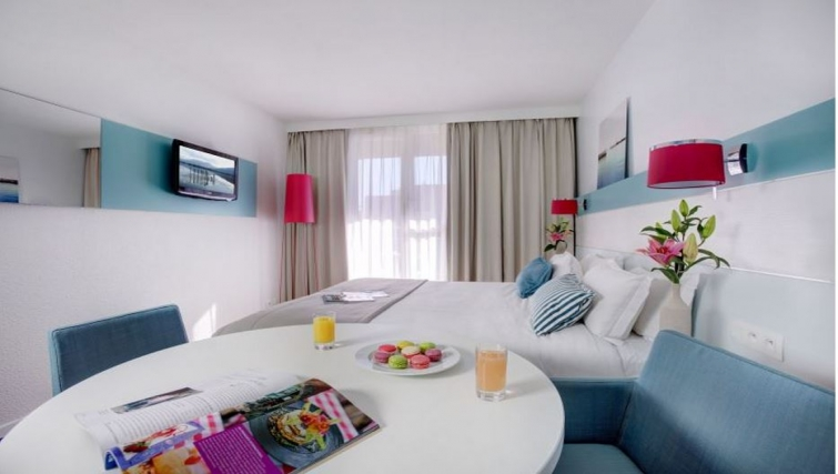 Modern bedroom in Citadines Castellane Apartments - Citybase Apartments