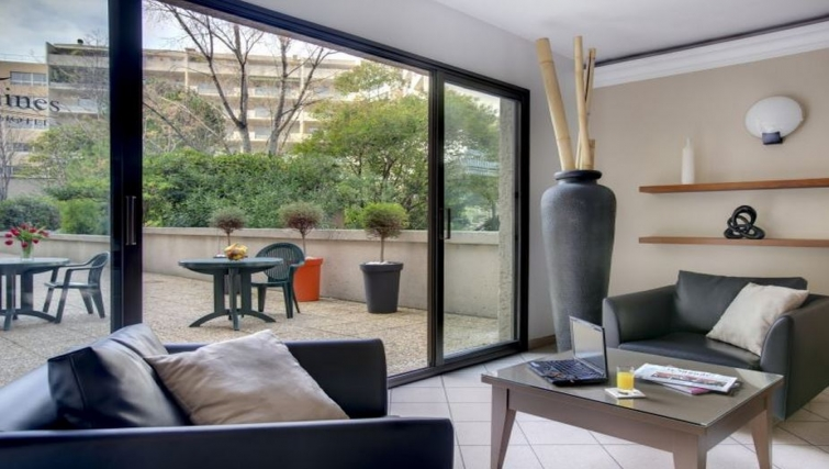 Bright lobby in Citadines Castellane Apartments - Citybase Apartments