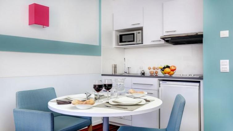 Dining area in Citadines Castellane Apartments - Citybase Apartments