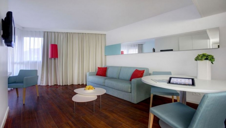 Contemporary living area in Citadines Castellane Apartments - Citybase Apartments