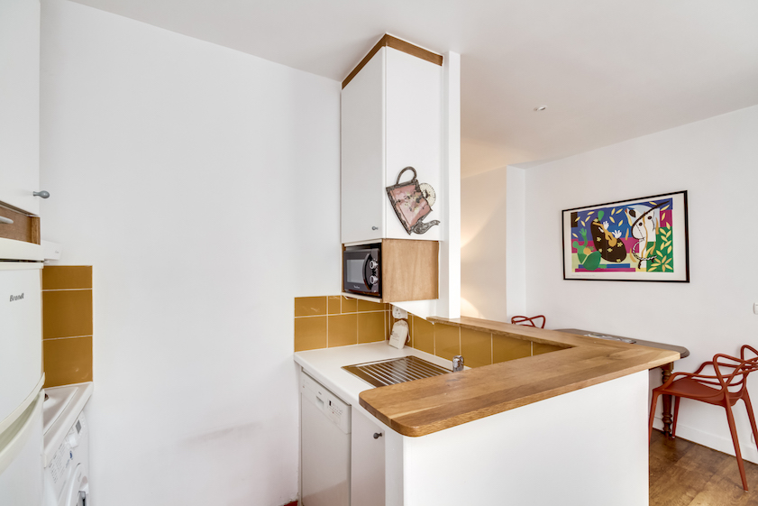 Kitchen at Rue Jean-Jacques Rousseau Apartment - Citybase Apartments