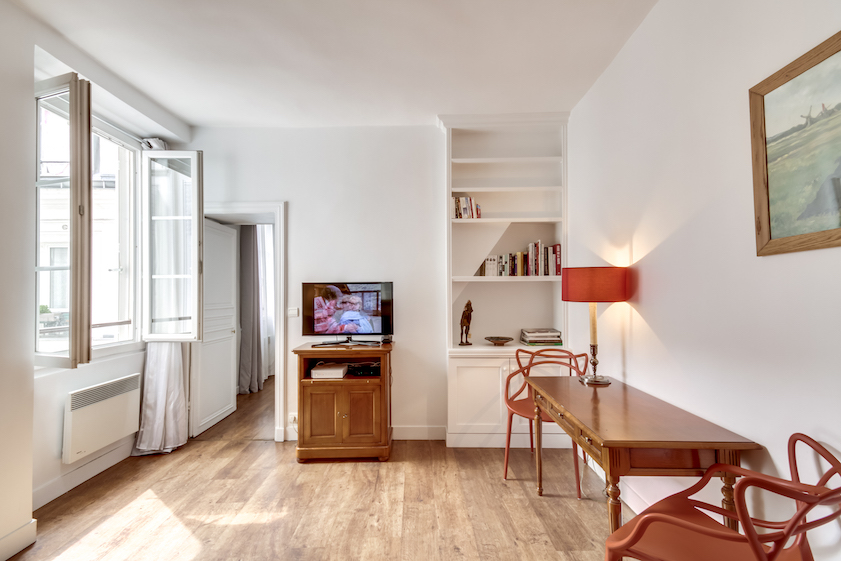 Bright living area at Rue Jean-Jacques Rousseau Apartment - Citybase Apartments