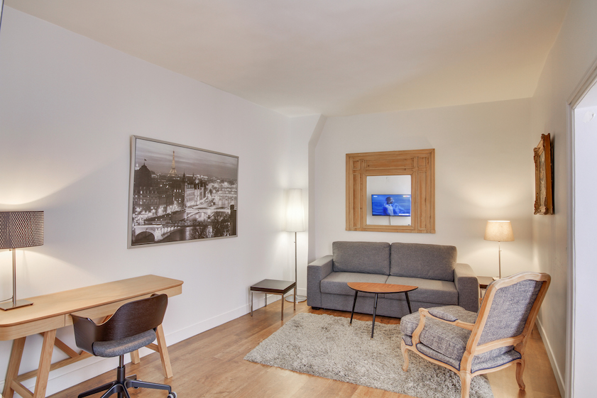 Living room at Rue Jean-Jacques Rousseau Apartment - Citybase Apartments