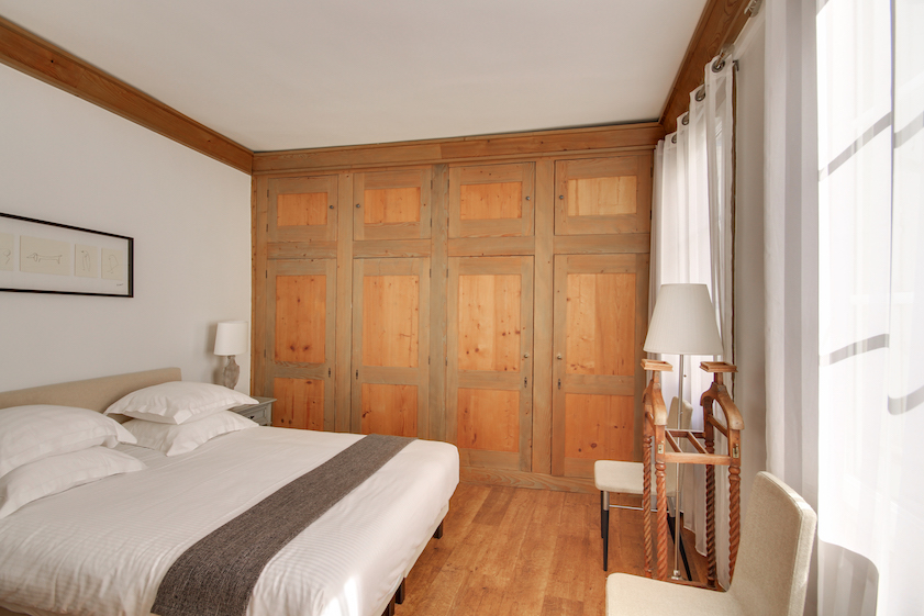 Bedroom at Rue Jean-Jacques Rousseau Apartment - Citybase Apartments