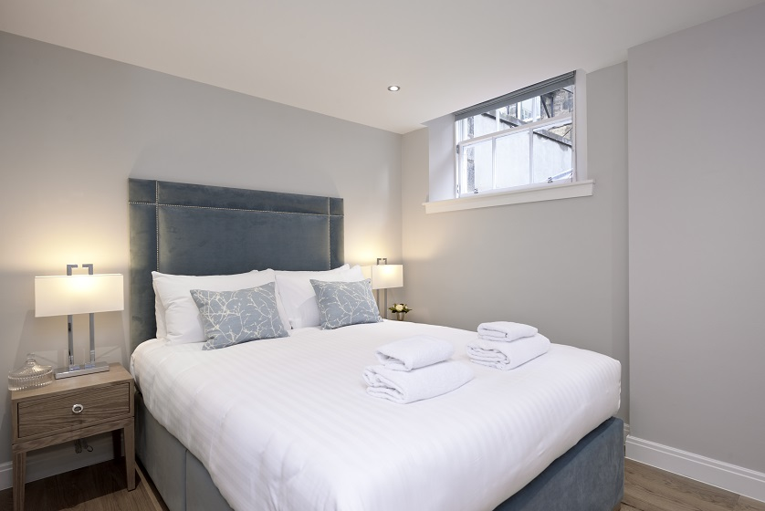 Cosy bedroom at New Town Serviced Apartments - Citybase Apartments