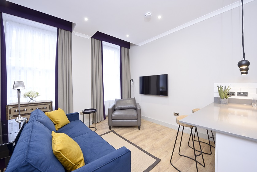Living room at Charlotte Square Apartments - Citybase Apartments