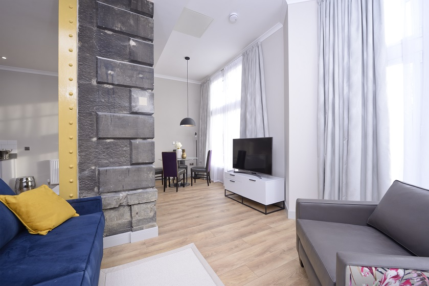 Bright living area at Charlotte Square Apartments - Citybase Apartments