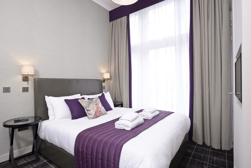 Bright bedroom at Charlotte Square Apartments - Citybase Apartments
